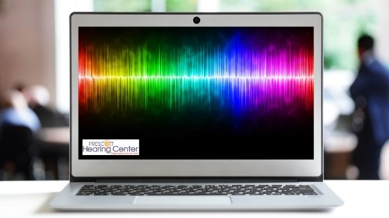 Picture of laptop, soundwaves, hearing test, start living in a world of great hearing performance, online hearing test