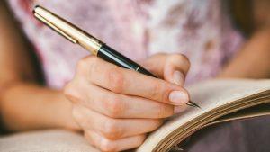 women writing-journal-tinnitus-strategies